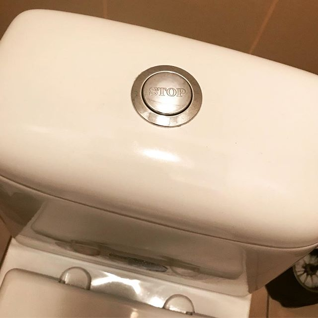 """This one has got me thinking, the flush button in the loo at the Ukraine office has a """"Stop"""" label ... my OCD is driving me nuts as to try to understand its significance!"""